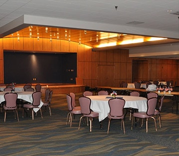 Banquet room with chairs and white table cloths