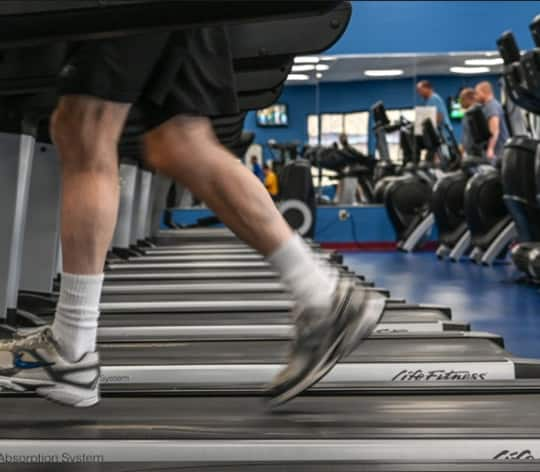 Group of people on treadmills