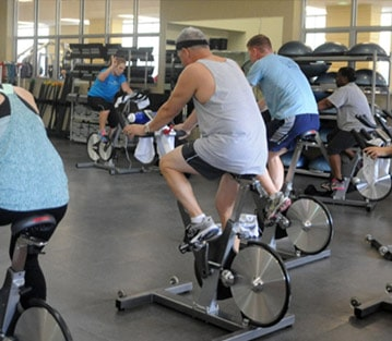 People in a cycling fitness class