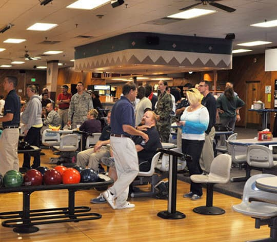 People hanging out at a bowling center enjoying themselves