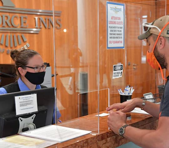 Air Force Inn receptionists greeting a guest