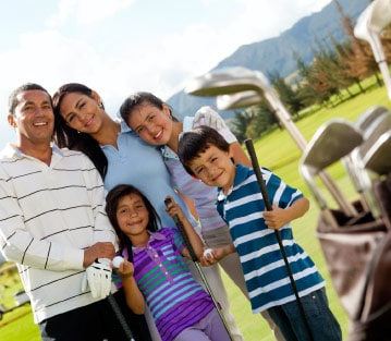 A family enjoying a day at a golf course