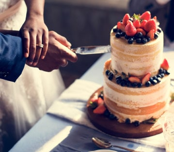 couple cutting a cake together