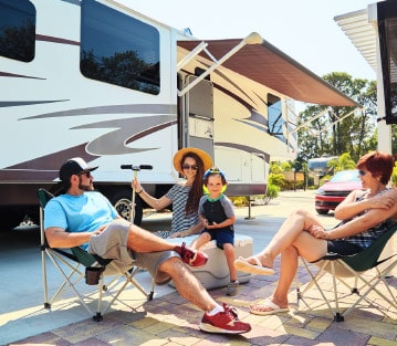 Family sitting in front of RV
