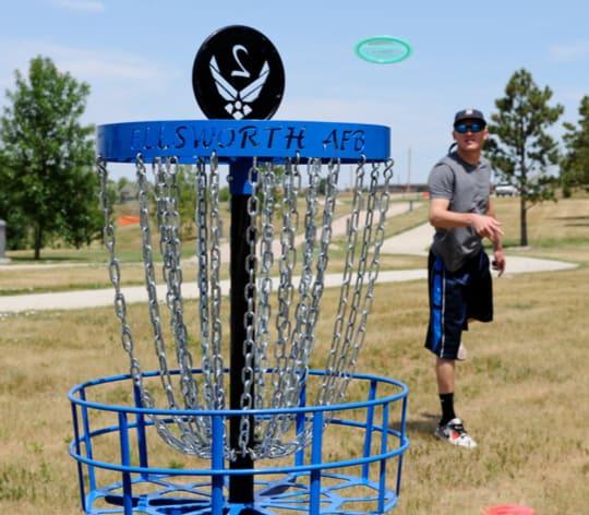 Airman playing fling golf