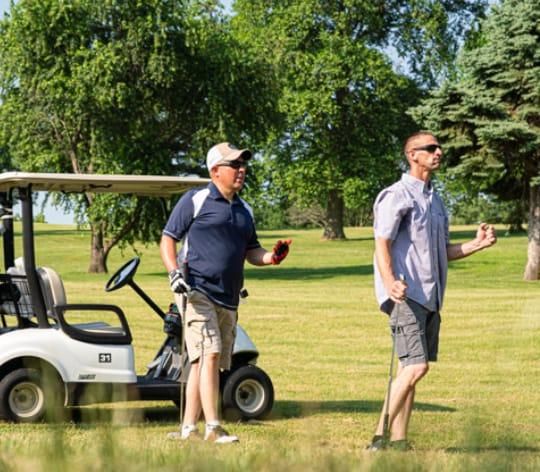 Group of men playing golf