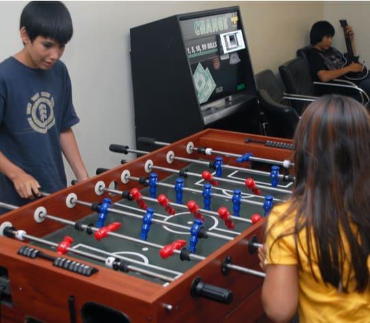 Boy and girl playing foosball