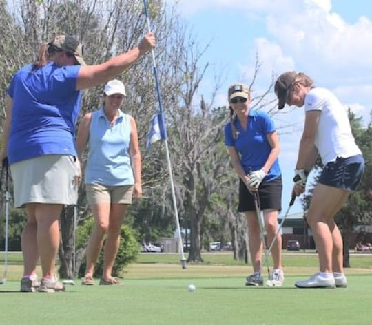 Group of women playing golf