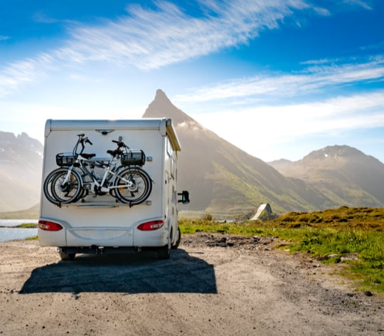 RV parked with mountains in sight